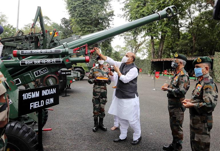 The Union Minister for Defence, Shri Rajnath Singh performs Shastra Puja at Sukna War Memorial, in Darjeeling, West Bengal on October 25, 2020. The Chief of the Army Staff, General Manoj Mukund Naravane is also seen.