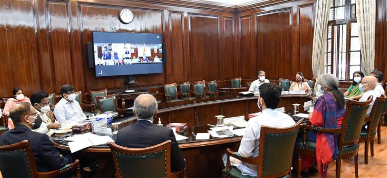 The Union Minister for Finance and Corporate Affairs, Smt. Nirmala Sitharaman presiding over a meeting between the senior officials of the Finance Ministry and the tax professionals, stakeholders and Infosys on issues in new Income Tax Portal, through video conferencing, in New Delhi on June 22, 2021. The Minister of State for Finance and Corporate Affairs, Shri Anurag Singh Thakur and the Secretary, Department of Revenue, Ministry of Finance, Shri Tarun Bajaj are also seen.