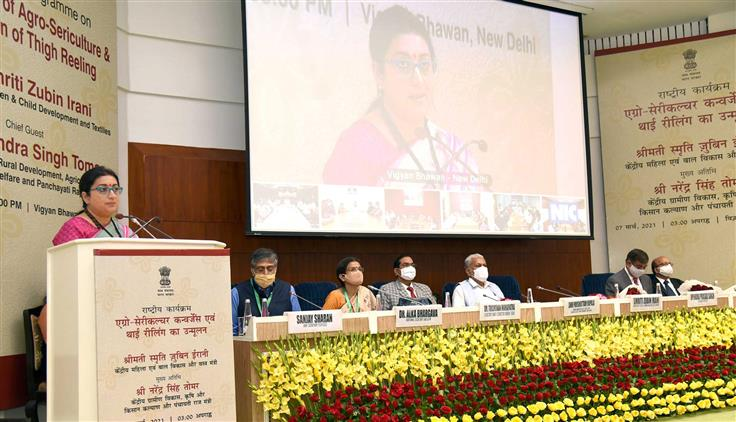 The Union Minister for Women & Child Development and Textiles, Smt. Smriti Irani addressing at the National level programme on Convergence of Agro-Sericulture & Eradication of Thigh Reeling, in New Delhi on March 07, 2021. The Minister of State for Agriculture and Farmers Welfare, Shri Parshottam Rupala, the Secretary, Textiles, Shri U.P. Singh and the Secretary (DARE) & Director General (ICAR), Dr. Trilochan Mohapatra are also seen.