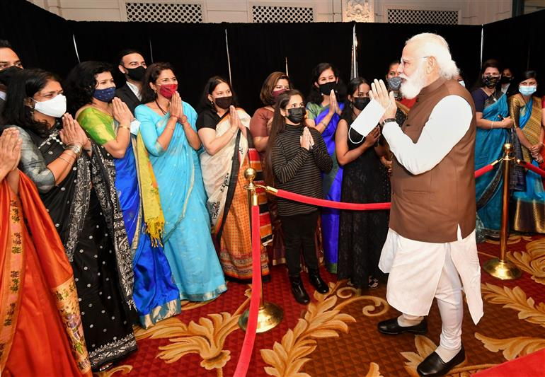 The Prime Minister, Shri Narendra Modi being greeted by the Indian Community on his arrival in Washington DC on September 22, 2021.